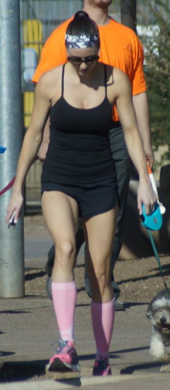 lovely dog walker lady in fitness shorts