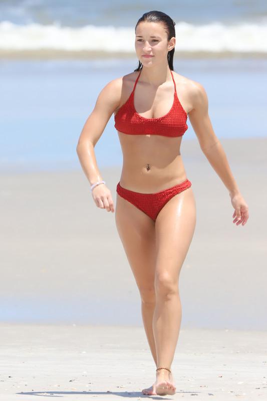 brunette beach babe in red bikini