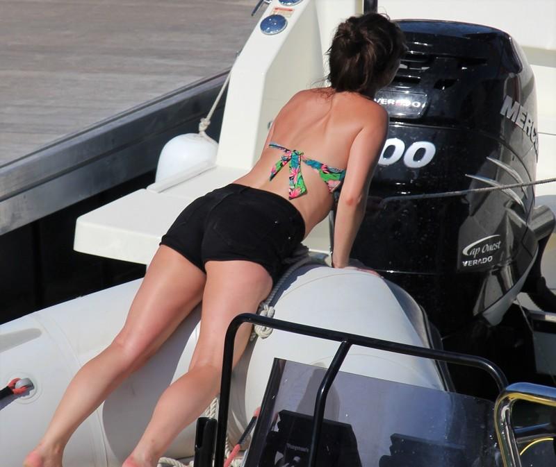 2 boat girls in shorts & bikini