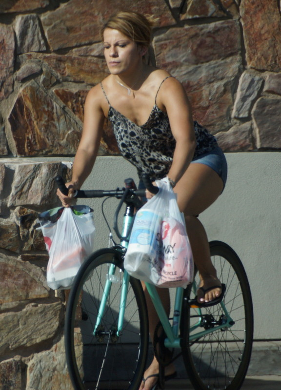 bicycle chick in denim shorts